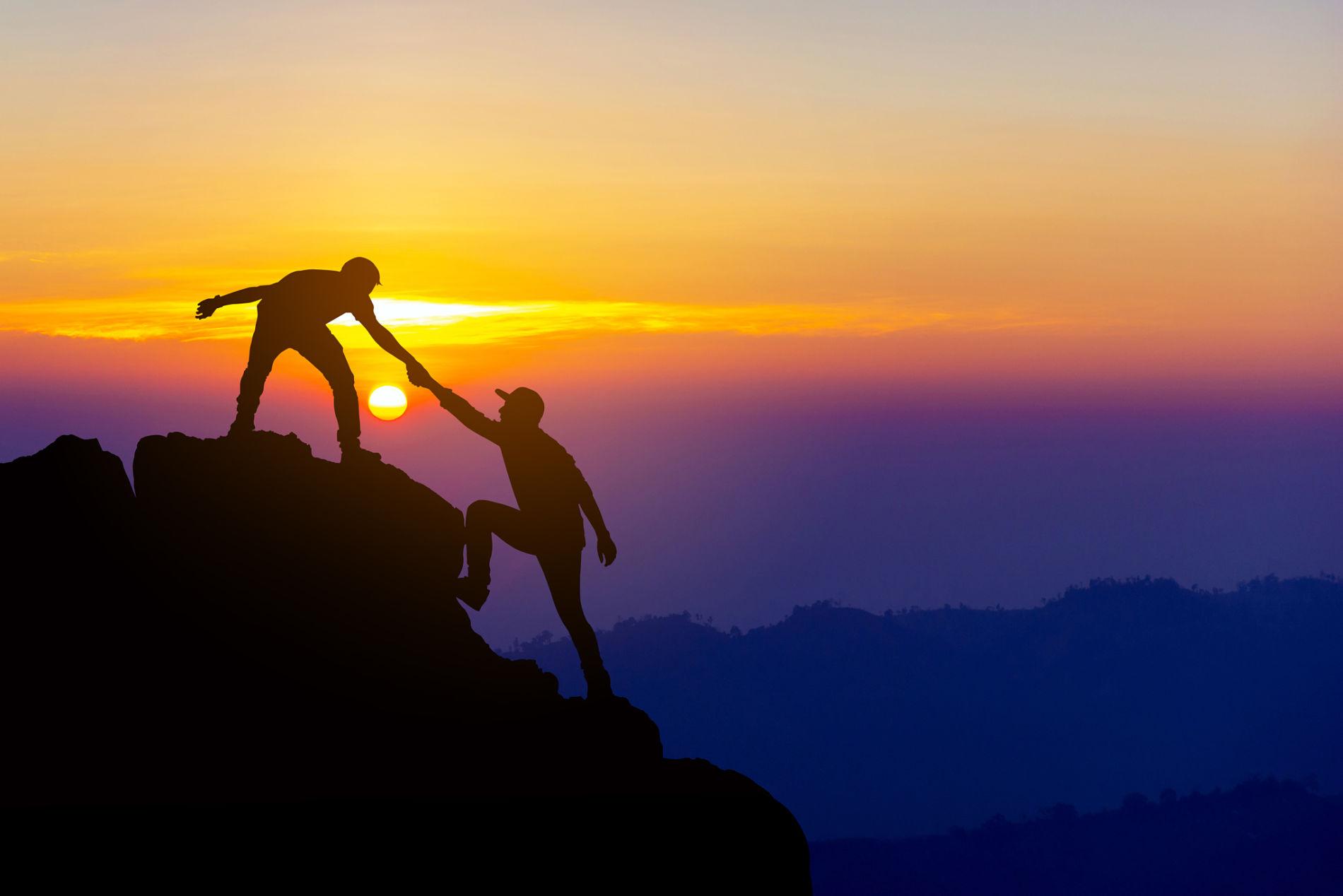 helping hand climb mountain